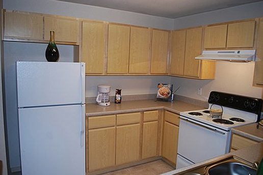 Kitchen with oven, fridge and cabinets